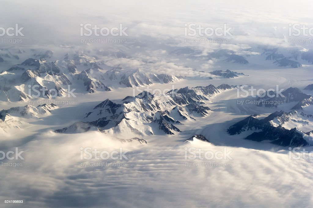 Greenland mountains and snow stock photo