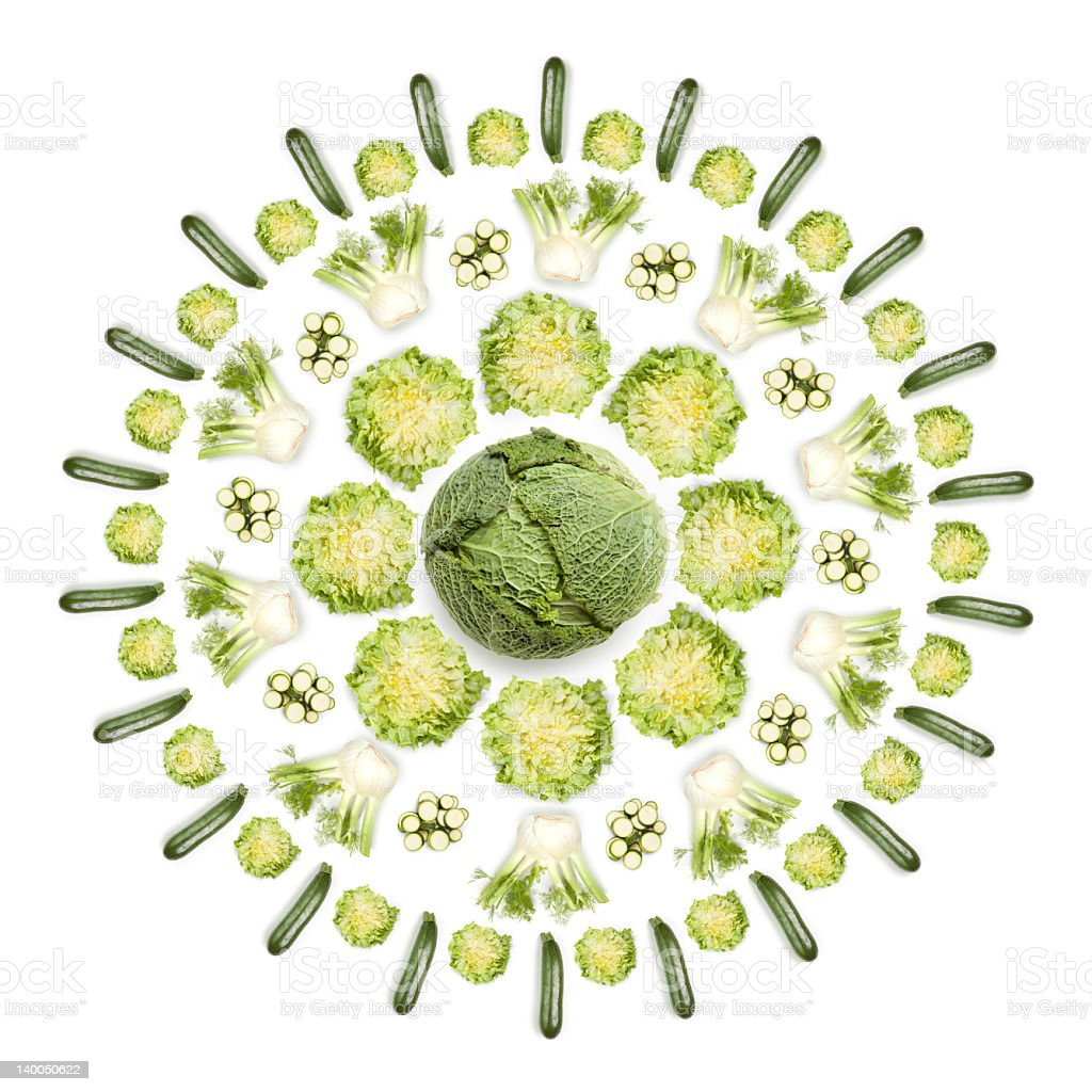 Greens sun: vegetables arranged in circular shape on white background stock photo