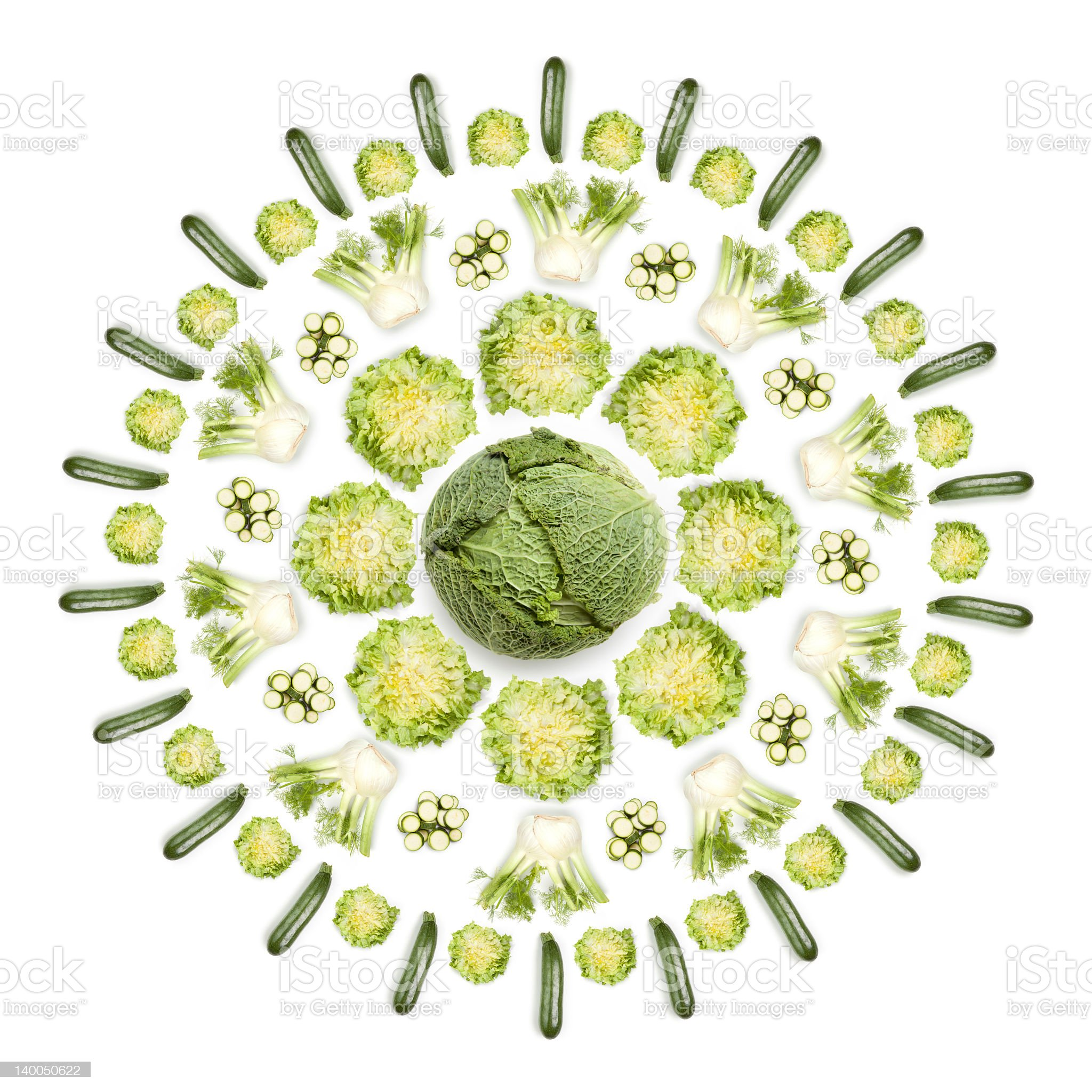 Greens sun: vegetables arranged in circular shape on white background royalty-free stock photo
