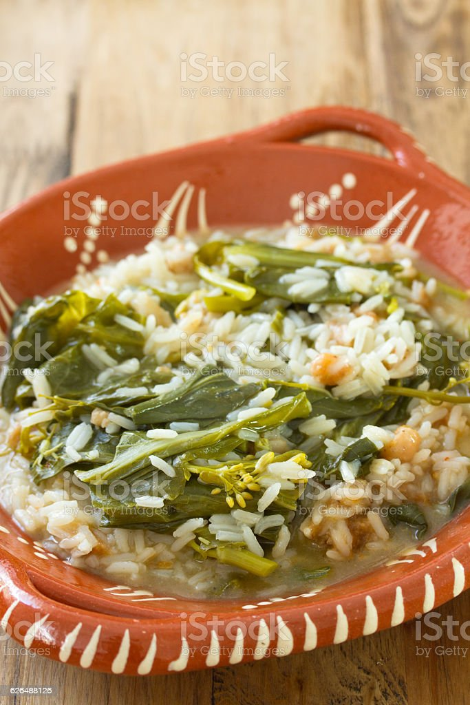 greens with farinheira and rice stock photo