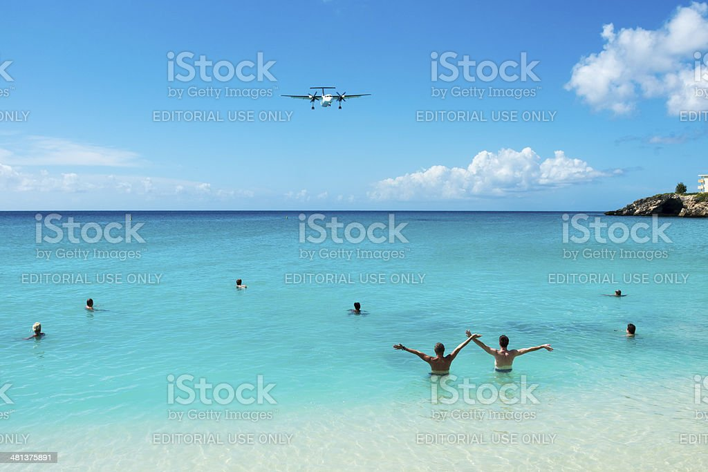Greeting a plane on St. Maarten stock photo