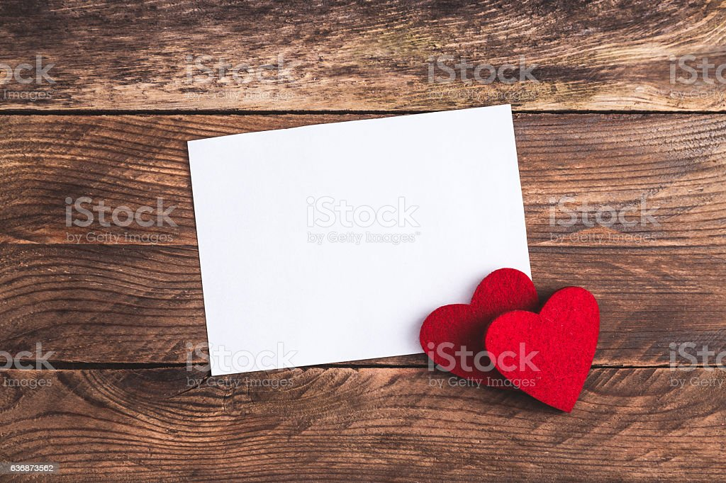 Greeting card, black gift on wooden background. stock photo