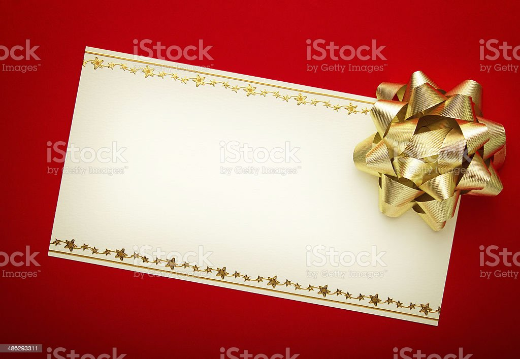 Greeting card on red paper with gold bow stock photo