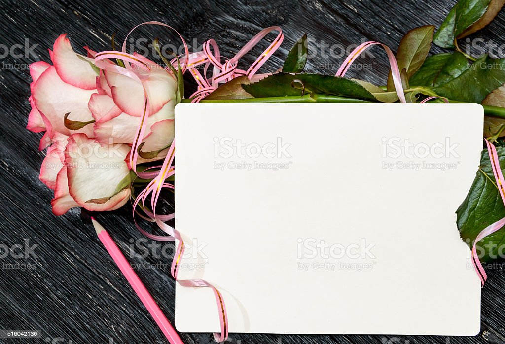 Greeting card. Three roses with blank card and pink pencil stock photo