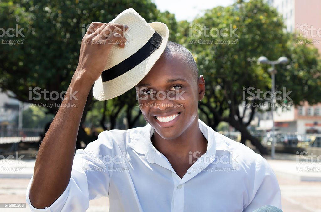 Greeting man from Cuba with straw hat stock photo