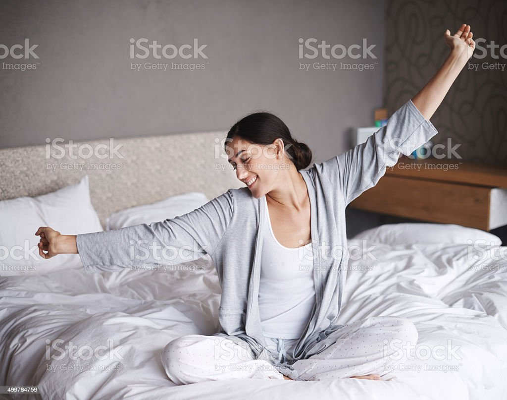 Greeting the daylight with a stretch stock photo