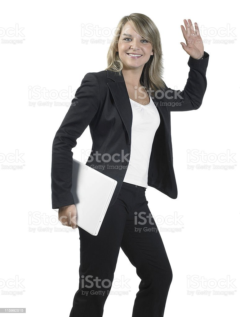 greeting young business woman with laptop stock photo