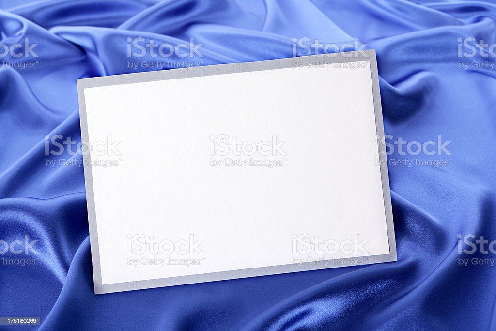 Greetings card with blue satin stock photo
