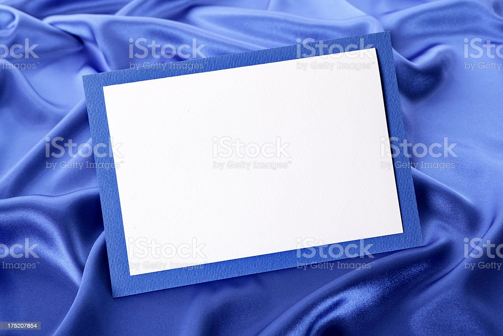 Greetings card with blue satin royalty-free stock photo