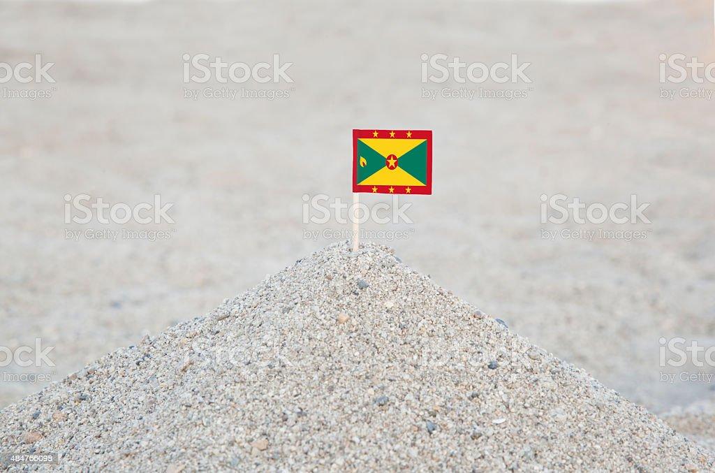 Grenada Flag on the Beach stock photo