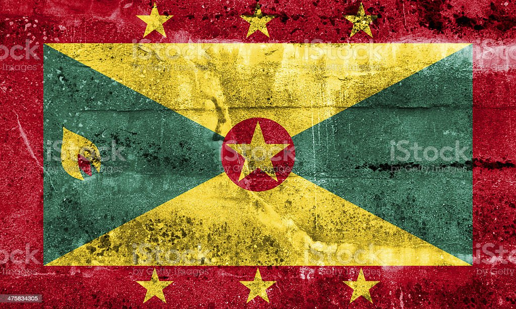 Grenada Flag painted on grunge wall stock photo