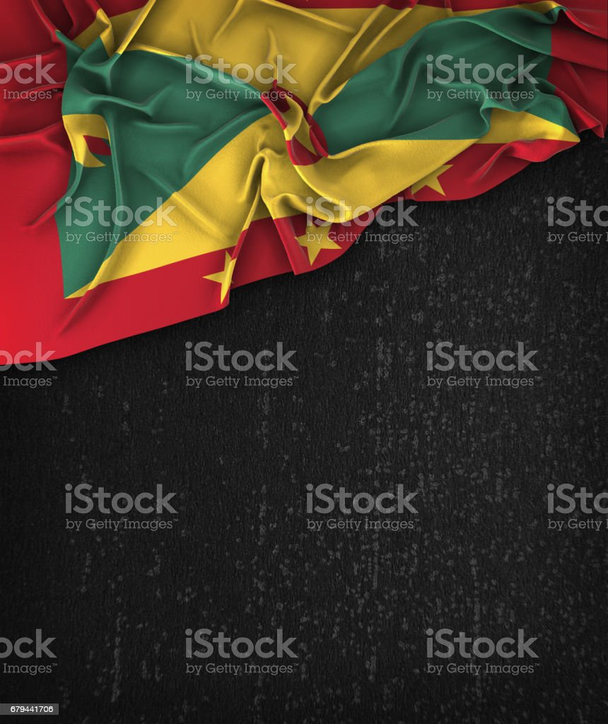 Grenada Flag Vintage on a Grunge Black Chalkboard With Space For Text stock photo