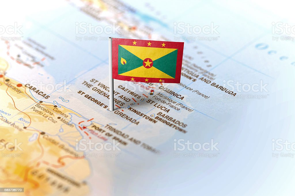 Grenada pinned on the map with flag stock photo