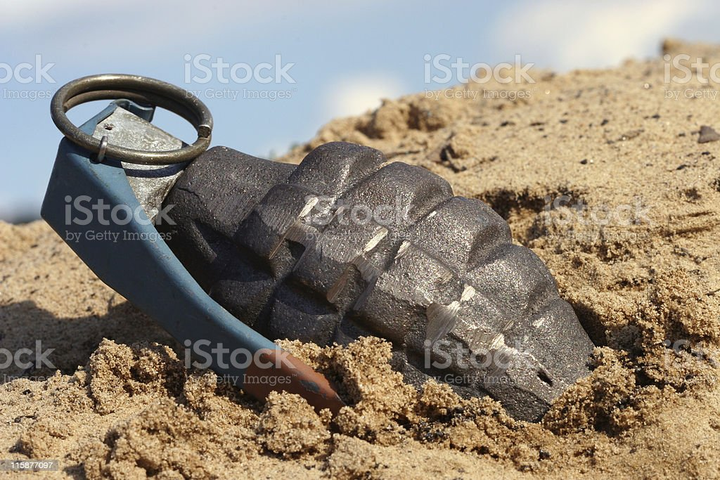 Grenade in Dirt stock photo