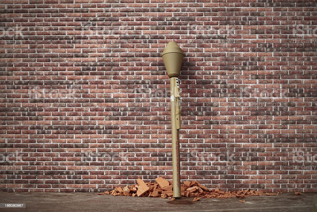 grenade launcher on a brick wall royalty-free stock photo
