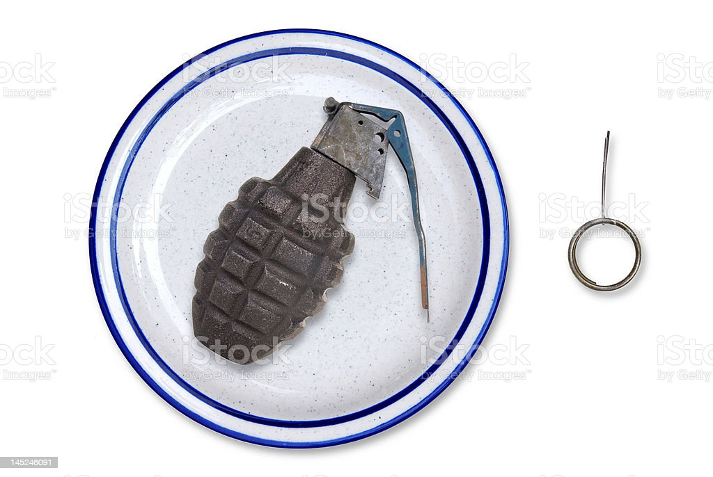 Grenade on a plate stock photo