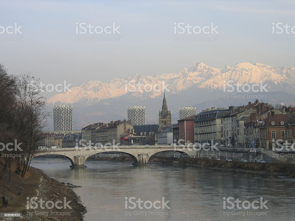 Grenoble is surrounded by mountains stock photo