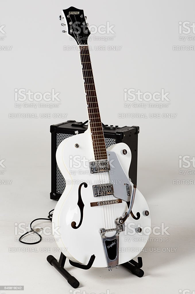 Gretsch G5120 Electromatic archtop guitar and Roland Cube 80GX amp stock photo