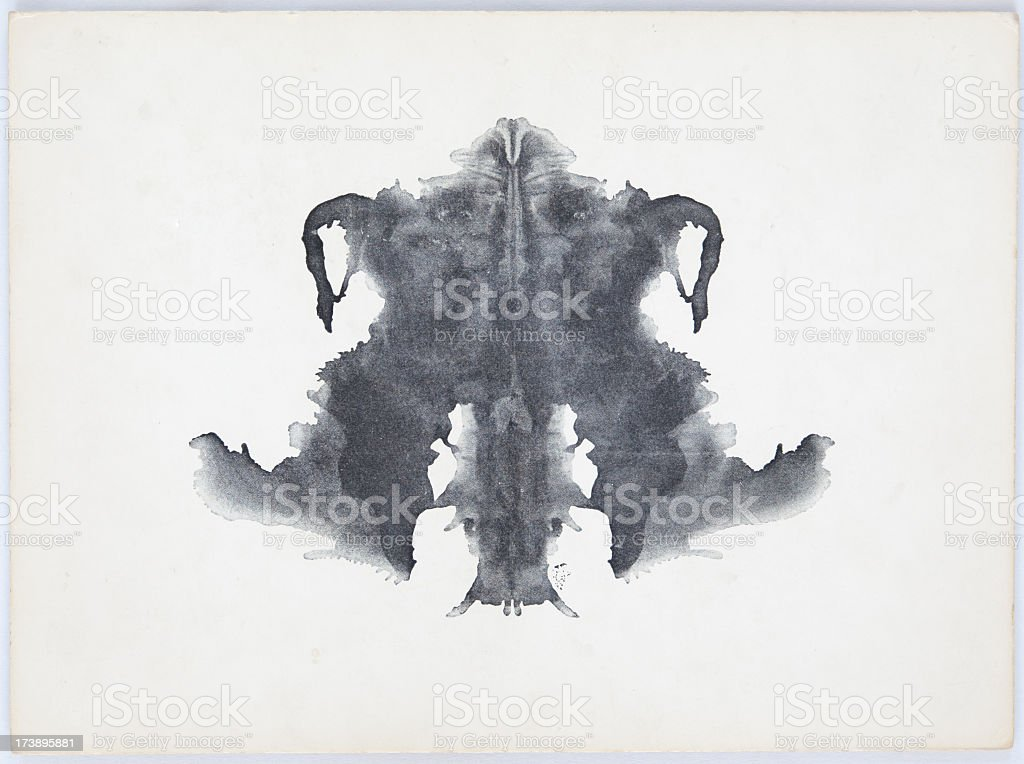 Grey and black Rorschach Ink Blot on a white background stock photo