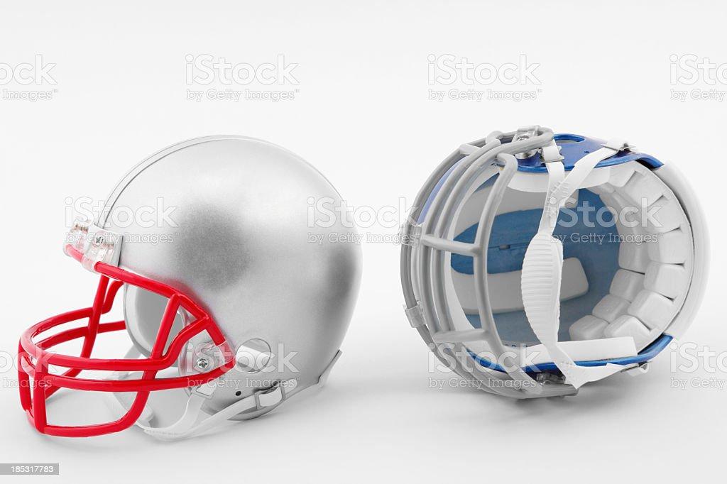 Grey and Blue American Football Helmets stock photo