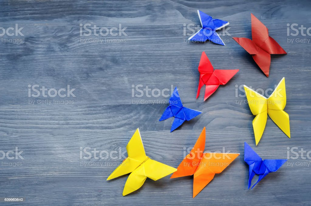 Grey background with paper multicolored butterflies stock photo