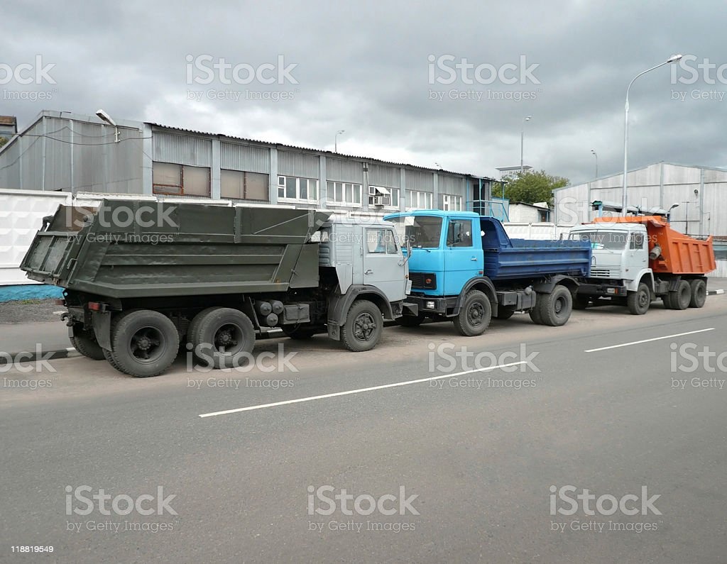 grey, blue and orange trucks on road royalty-free stock photo