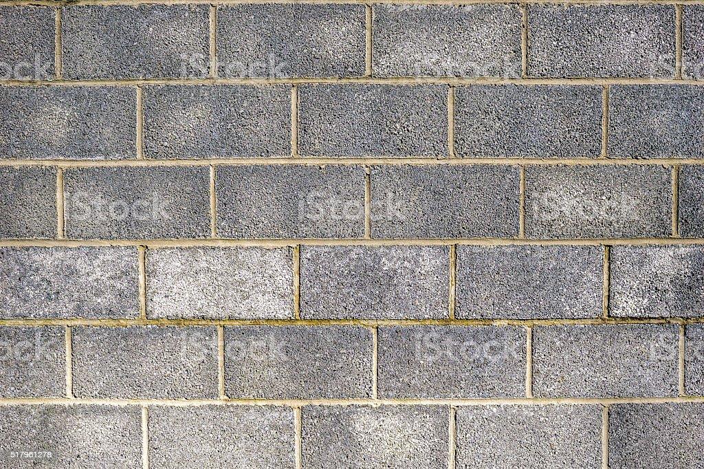 Grey breeze block brick wall texture background stock photo