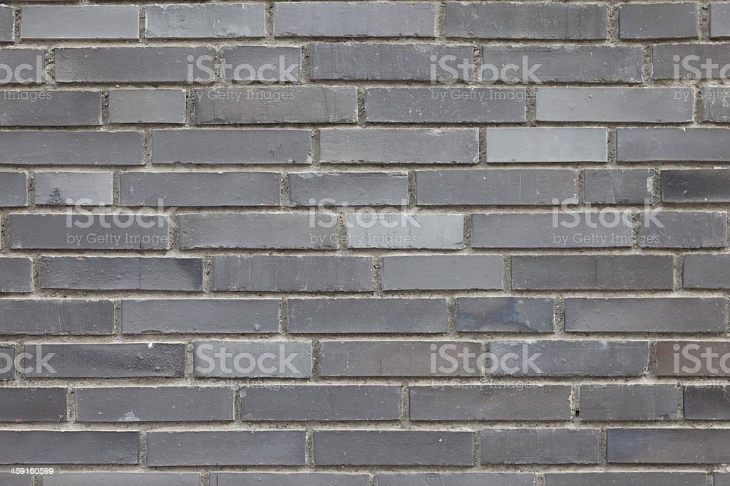 grey brick wall surface, plan view / zoom, overcast sky stock photo