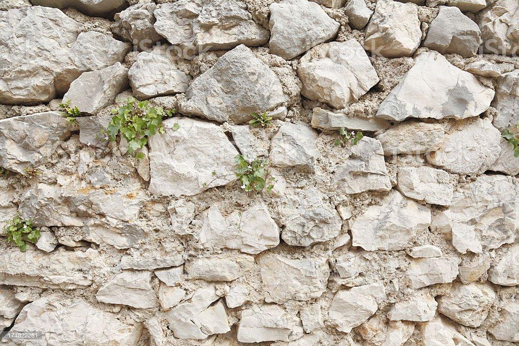 grey brown rugged natural rock stone wall Croatia royalty-free stock photo