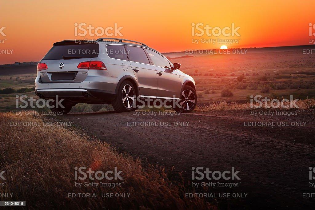 Grey car Volkswagen Passat stay on dirt road stock photo