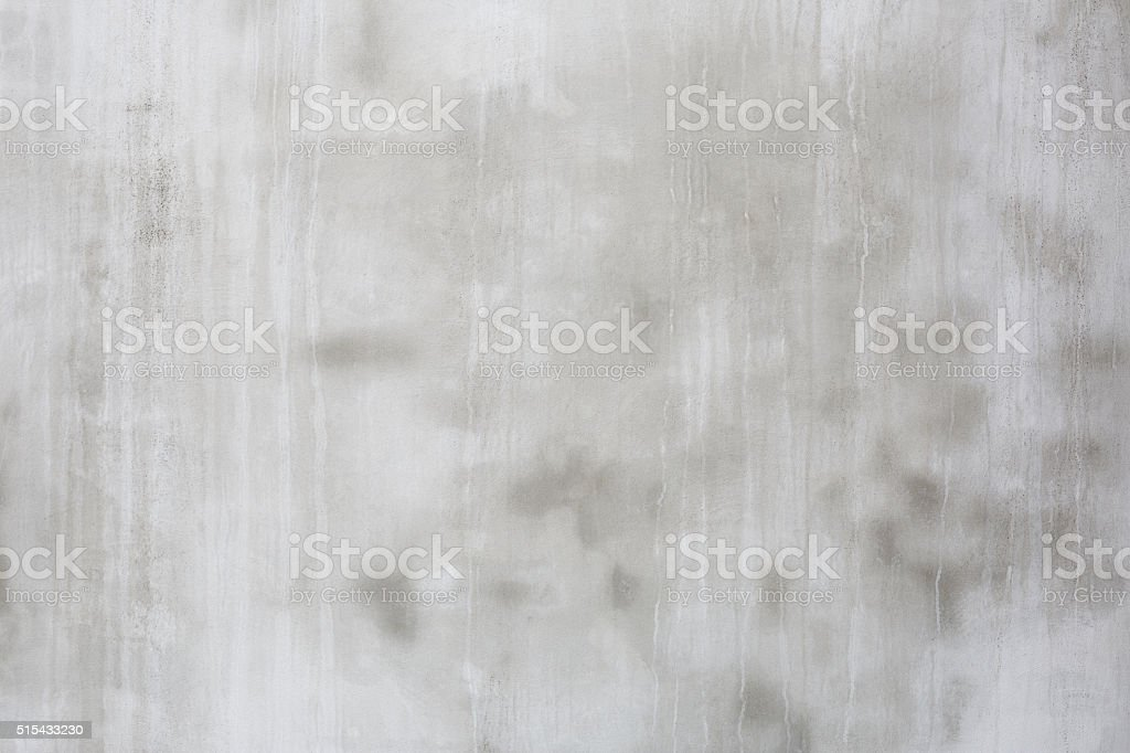 Grey cement wall with dripping water traces, background stock photo