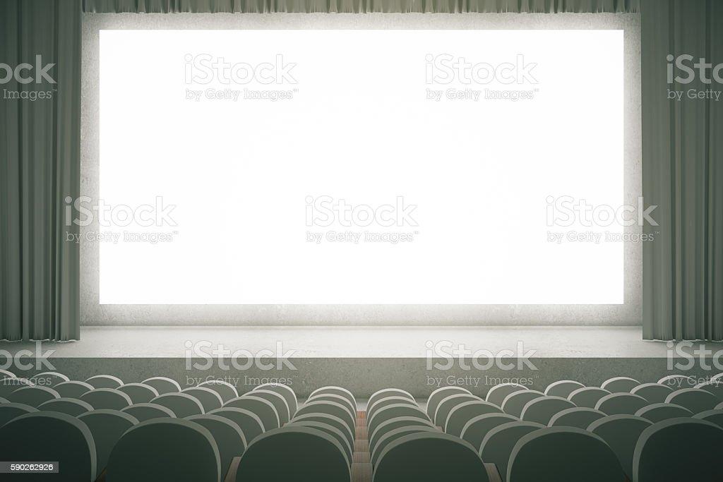 Grey cinema with blank screen stock photo