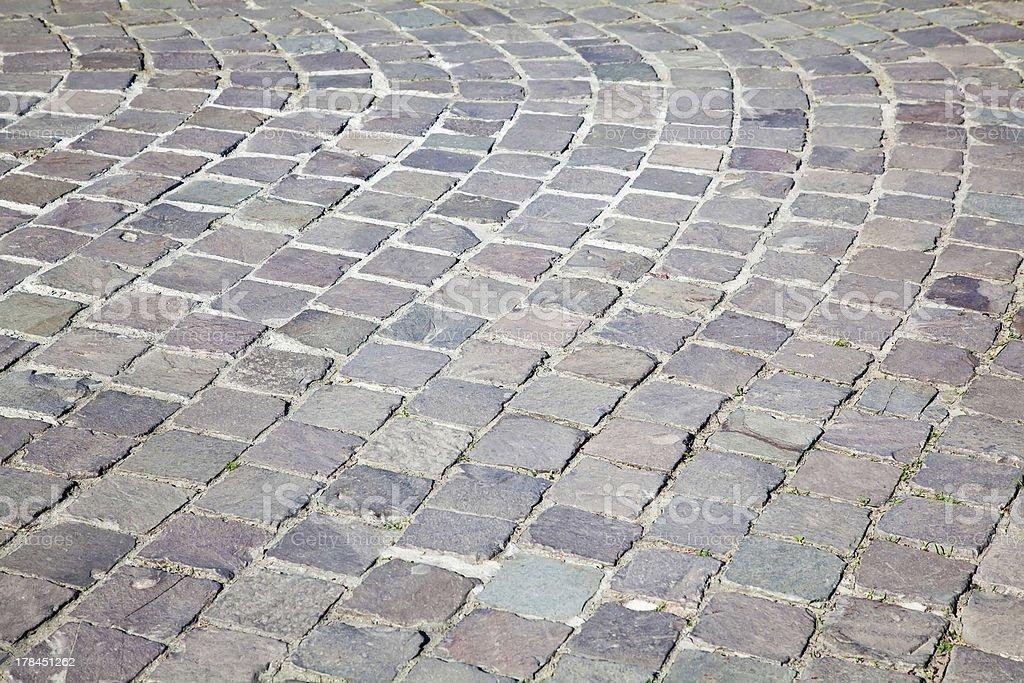 Grey cobblestone boulevard background texture royalty-free stock photo