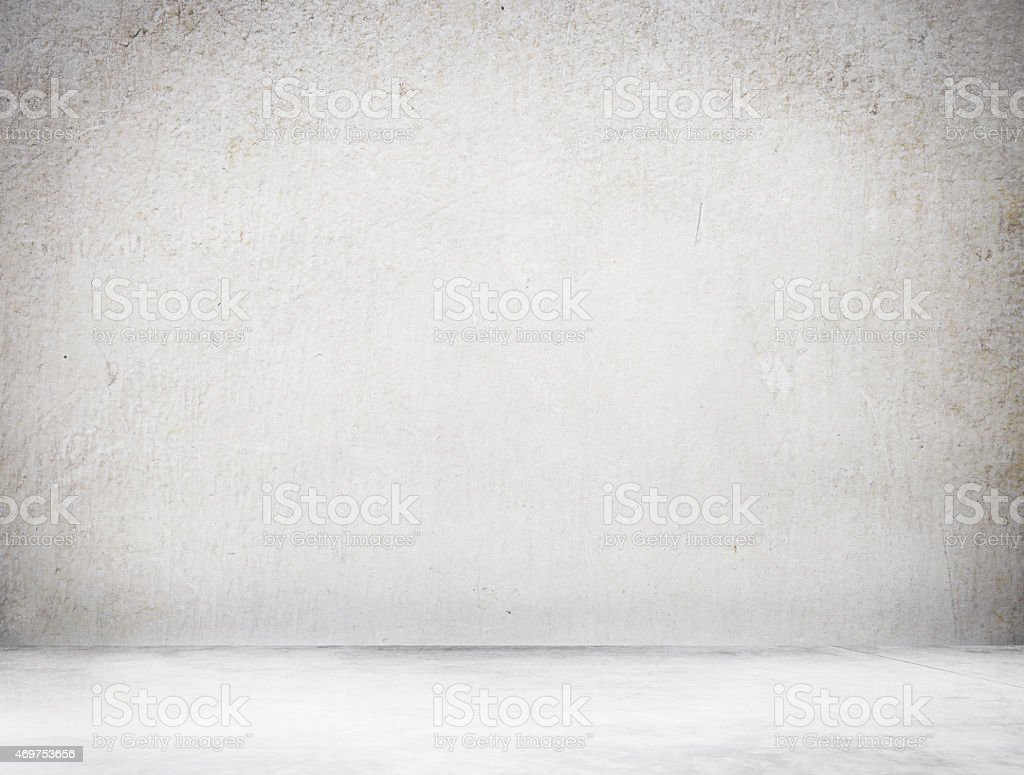 A grey concrete textured wall and floor stock photo