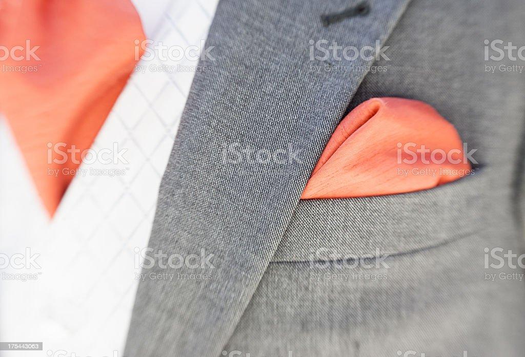 Grey dress Suit orange tie and pocket handkerchief. stock photo