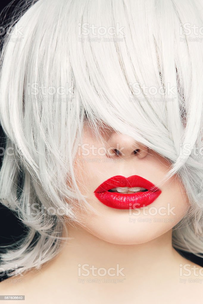 Grey hair and red lipstick stock photo