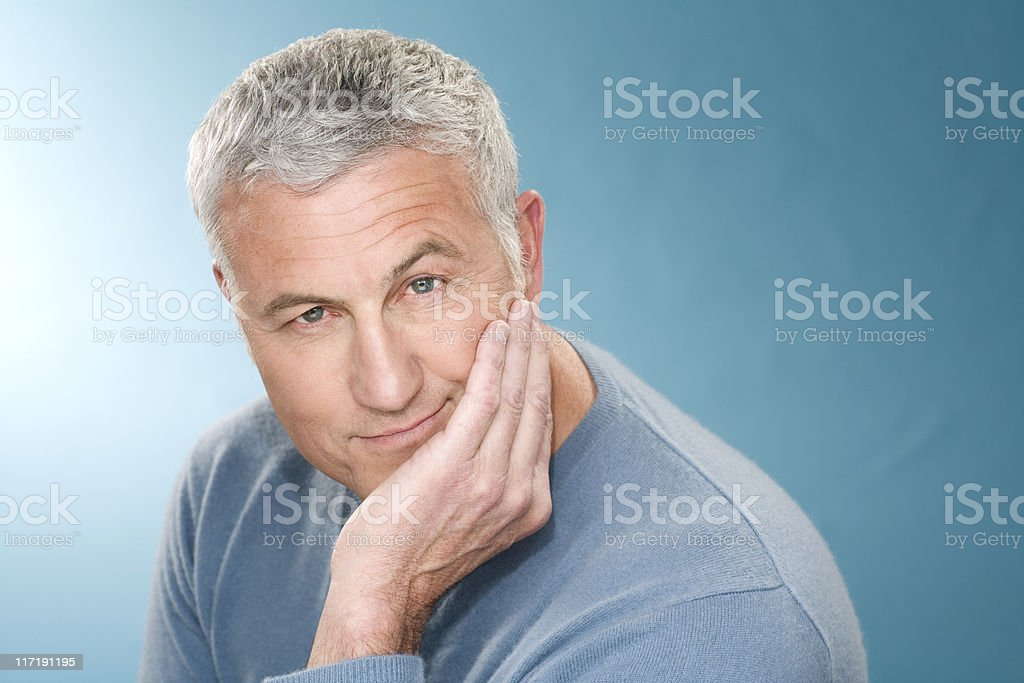 Grey hair man with head rest in hand stock photo