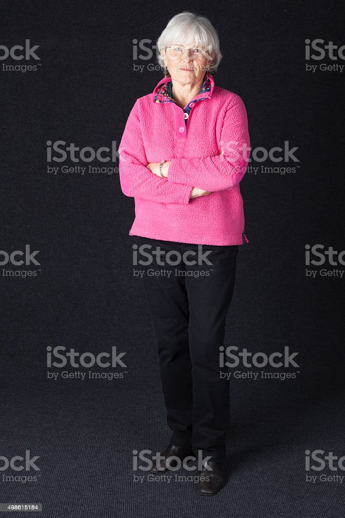 Grey Haired Senior Lady Wearing A Pink Fleece stock photo