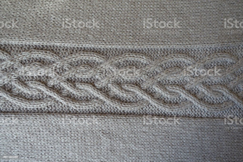 Grey handmade knit fabric with plait pattern stock photo