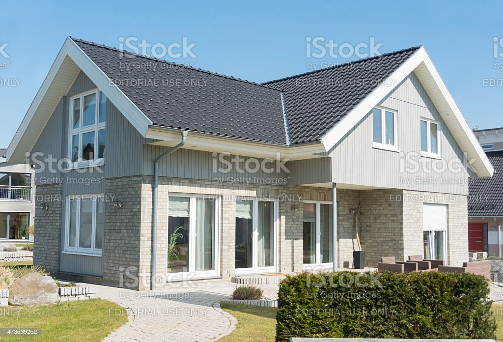 grey house private home with garden stock photo