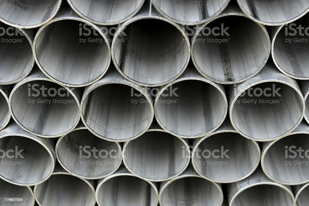 Grey industrial pipes piled up royalty-free stock photo