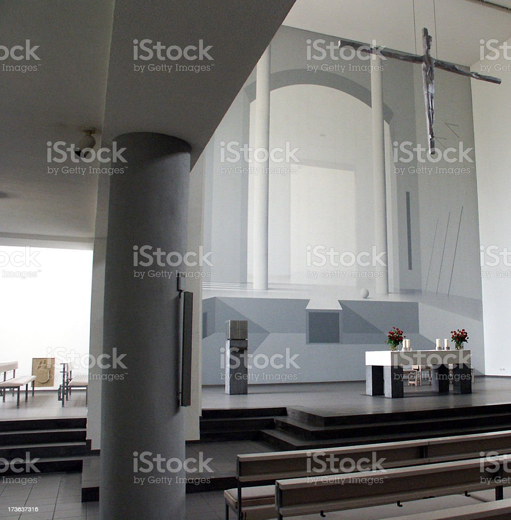 Grey inside of church with altar and steps stock photo