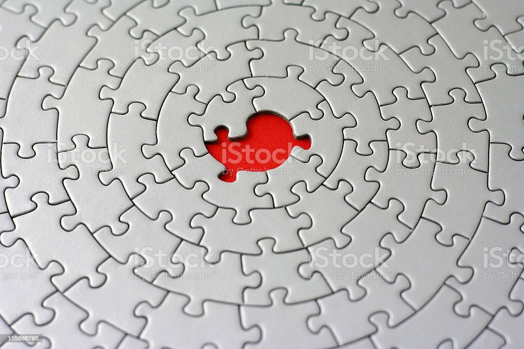 grey jigsaw with one missing piece royalty-free stock photo