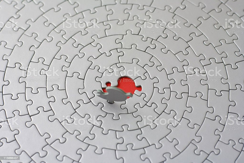 grey jigsaw with the last piece upstanding royalty-free stock photo