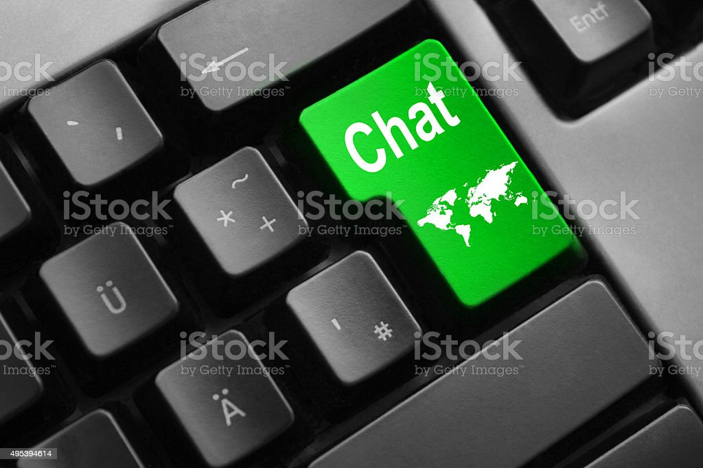 grey keyboard with green enter key chat stock photo