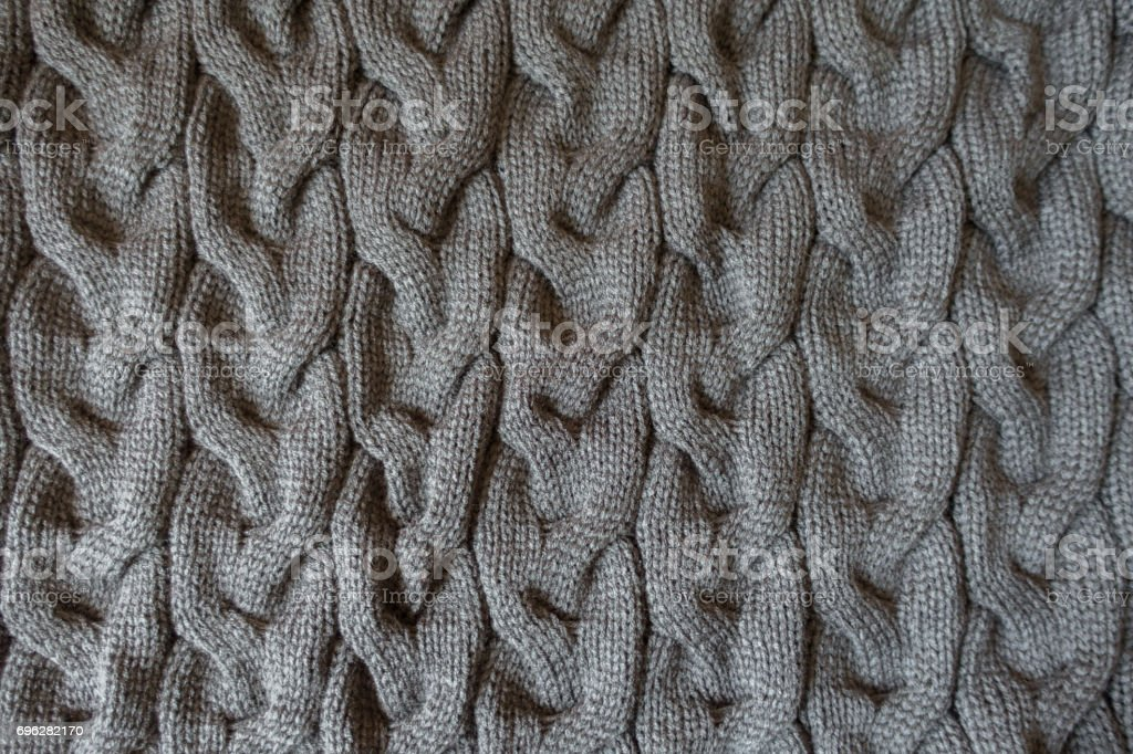 Grey knit fabric with plait pattern from above stock photo