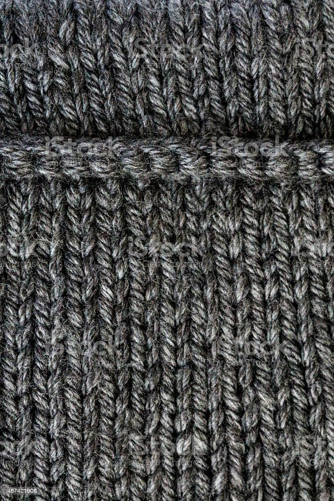 Grey knit macro with a horizontal line and vertical composition stock photo