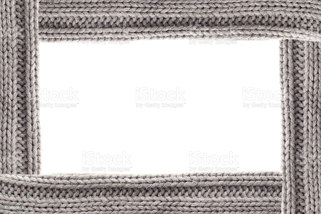 Grey knitted border with free space stock photo