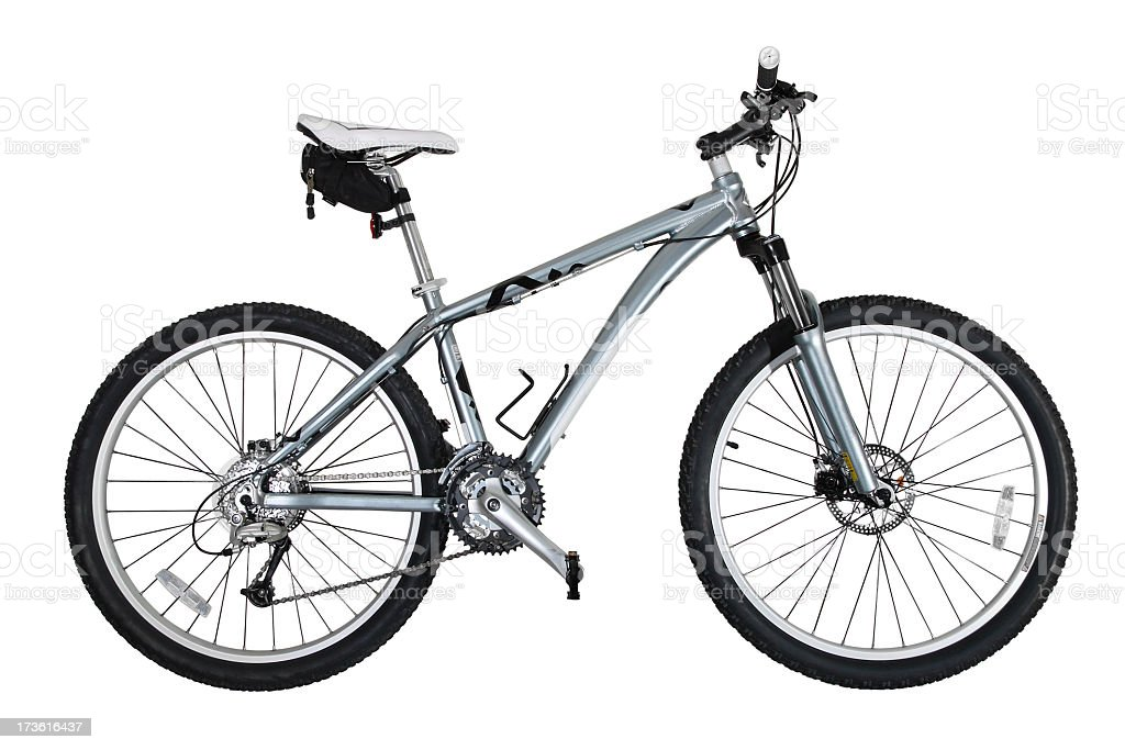 A grey mountain bicycle with black tires and white seat  royalty-free stock photo