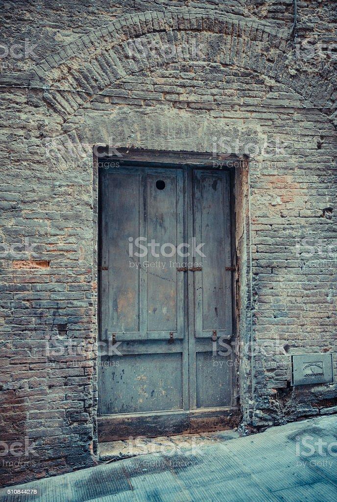 Grey past - Antique humble door stock photo